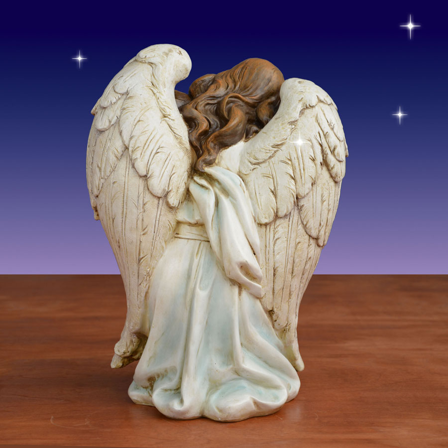 Rear view of kneeling angel