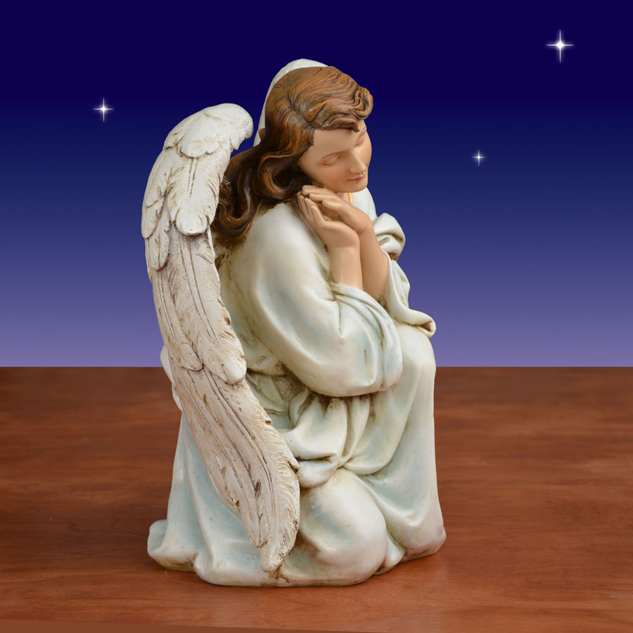 Side view of kneeling angel