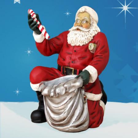 Life Size Kneeling Santa with Sack from Bay Designs